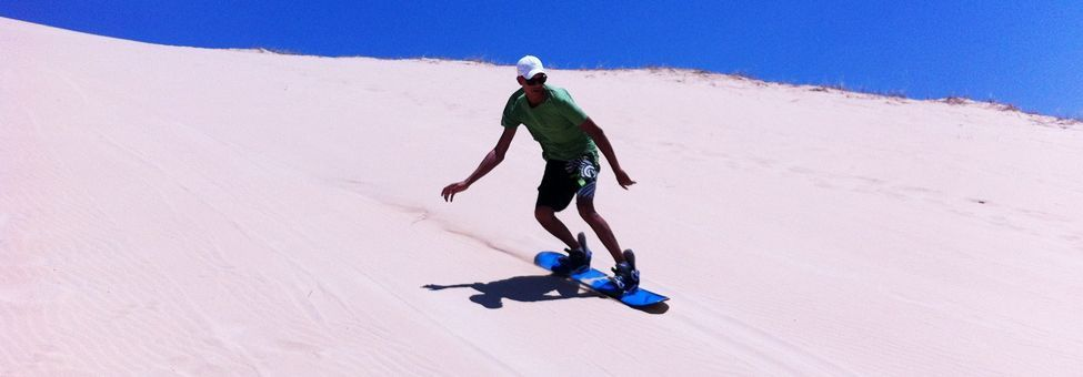SAND BOARDING A JEFFREY'S BAY